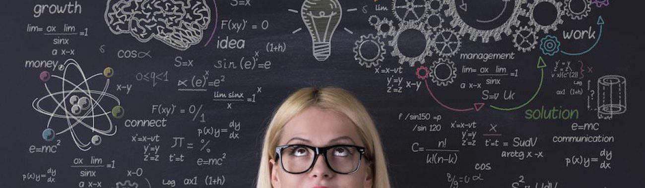 Business woman thinking on the blackboard